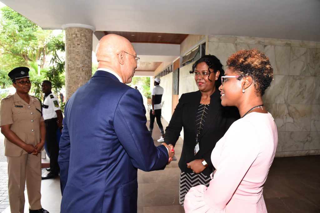 Sir Patrick Allen ON, GCMG, CD, KSt. J, Governor General of Jamaica, greeted by Mrs. Charmain Felter, Chair of CAROSAI and President of SAI Suriname.