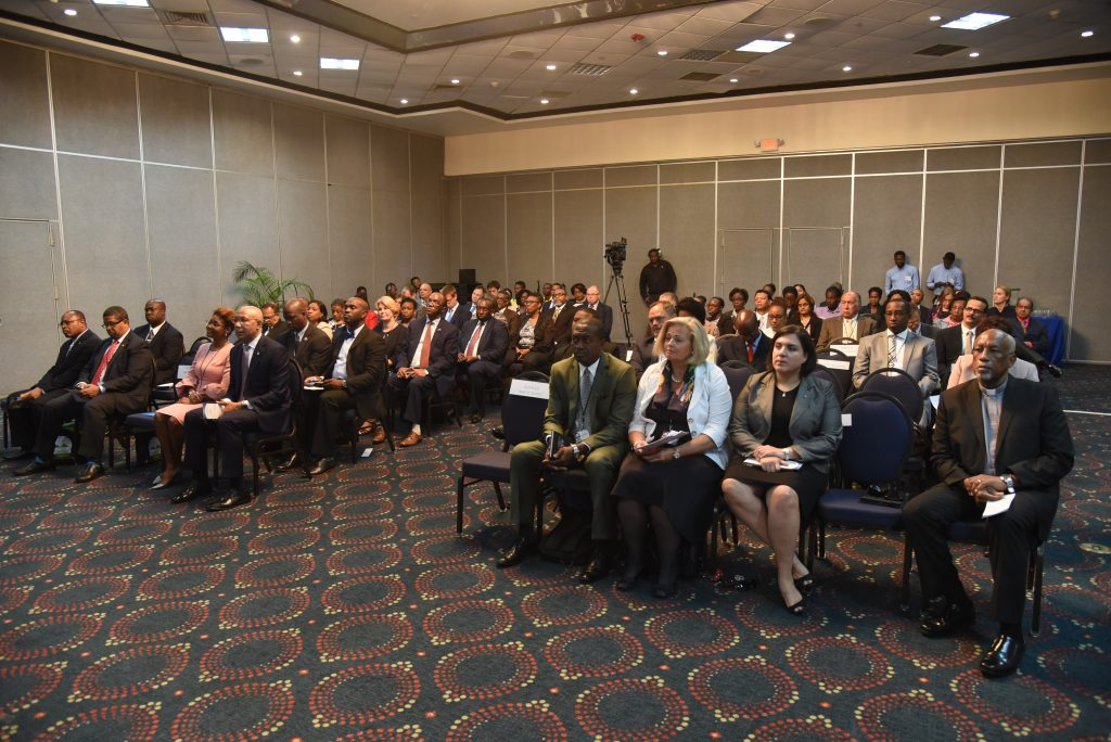Attendees look on at the CAROSAI 30th Anniversary Conference Opening Ceremony.